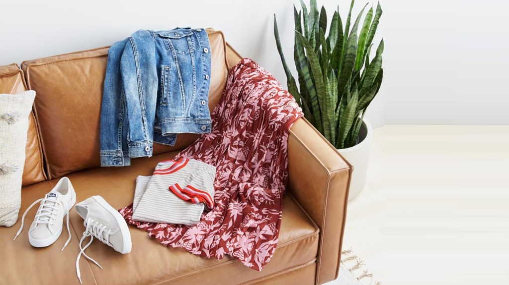 clothes laid out on a couch