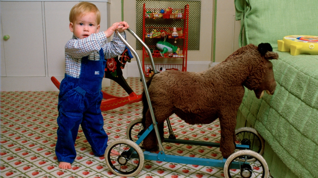 Toddler Prince Harry with a toy horse