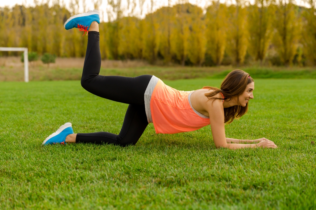 Woman doing donkey kick exercise