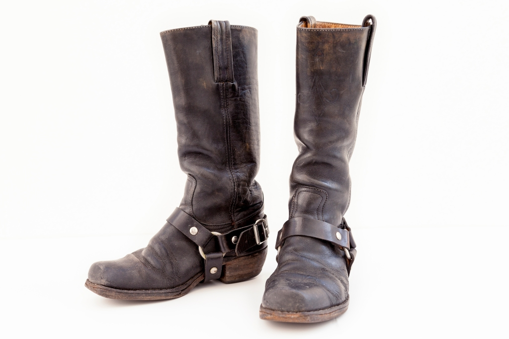 Close-Up Of Leather Boots Against White Background