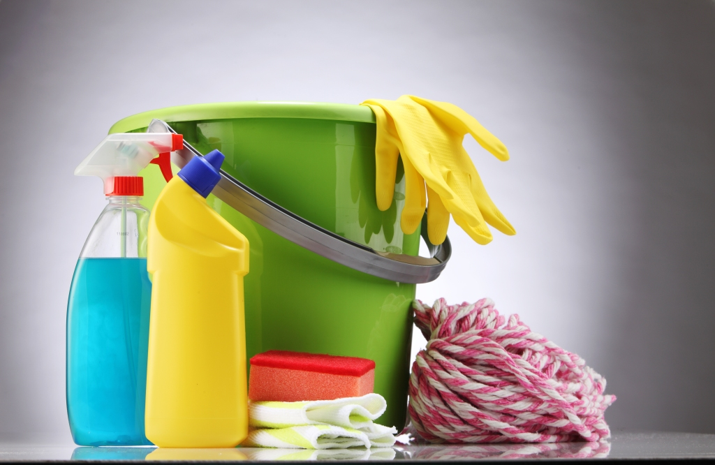 Close-Up Of Bucket With Cleaning Equipment On White Background