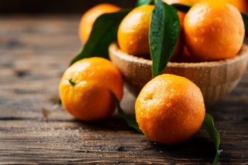 Fresh sweet mandarins on the wooden table, selective focus