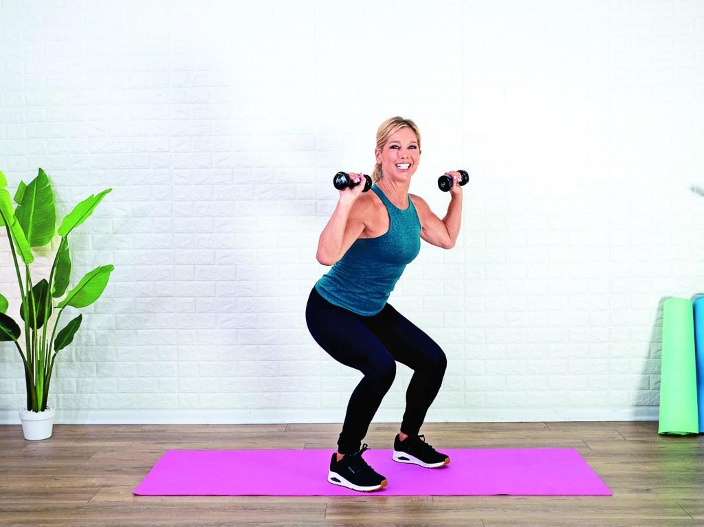 Denise Austin doing squat and press