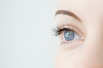close up of a woman's eye with light shining in it