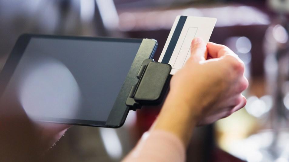 Woman swiping gift cards