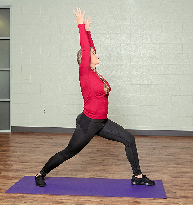Woman doing Road Warrior yoga pose