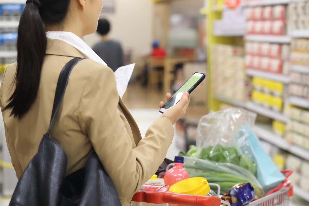 Woman shopping and looking at her phone