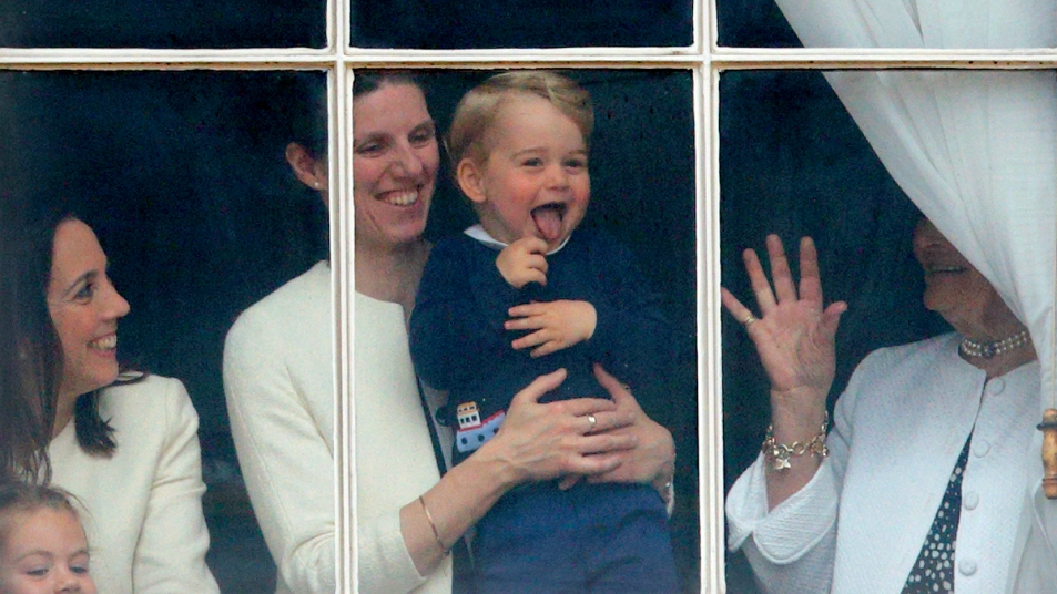Maria Borrallo holding Prince George while he waves from a palace window