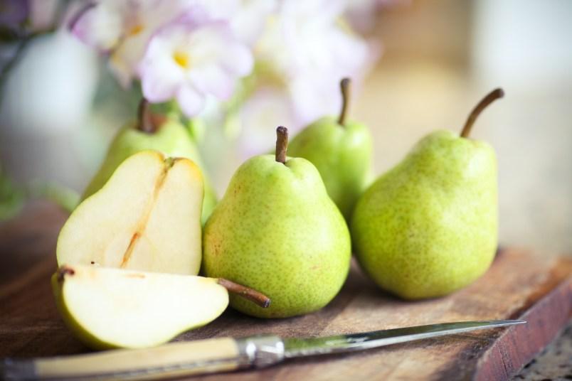 Green Pears on Wooden Board