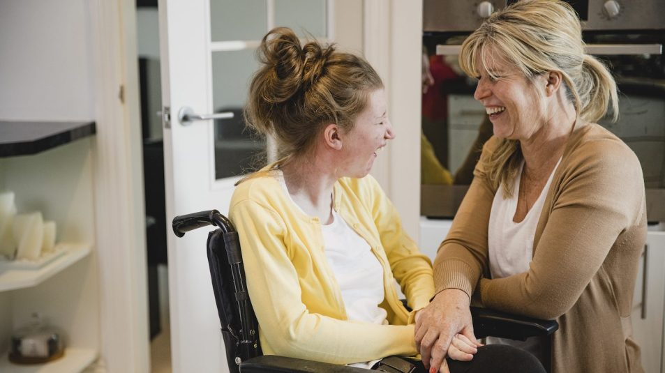 Mum and Disabled Daughter in Kitchen