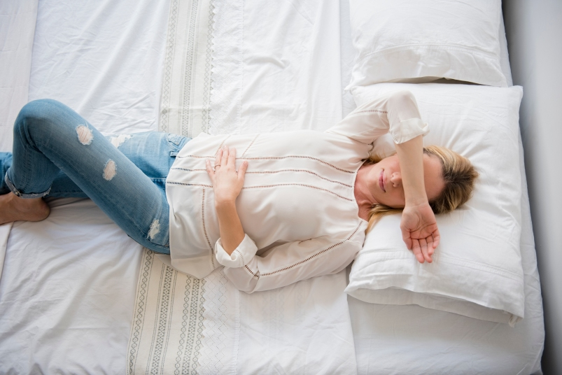 tired woman on bed
