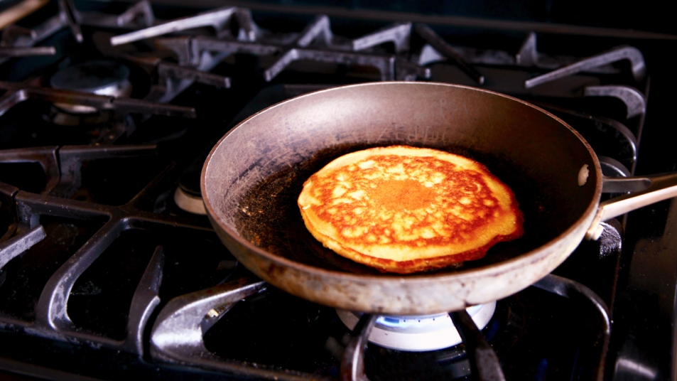 Pancake cooking on a stove