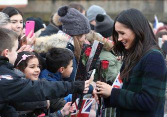 Meghan Markle receives roses from children
