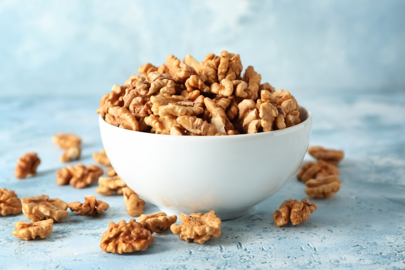 white bowl filled with walnuts