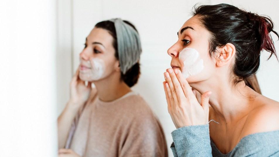Women applying face masks