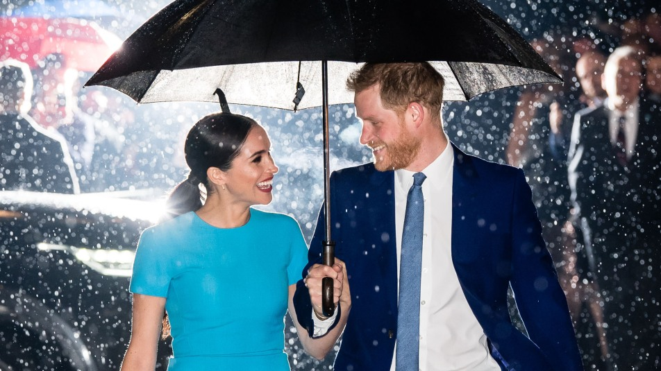 prince harry and meghan markle in the rain