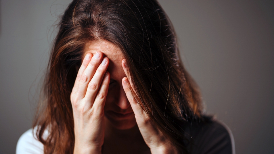 Woman clutching her head