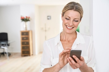 woman using wellness apps to feel better