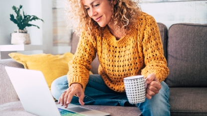 Woman smiling at her computer