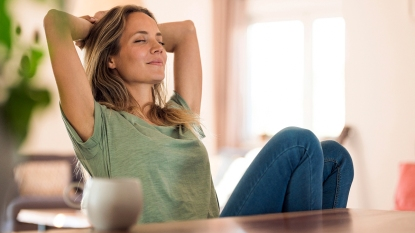Woman smiling with eyes closed