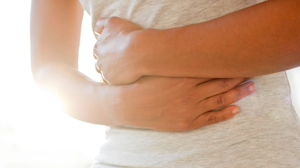 Woman clutching her stomach
