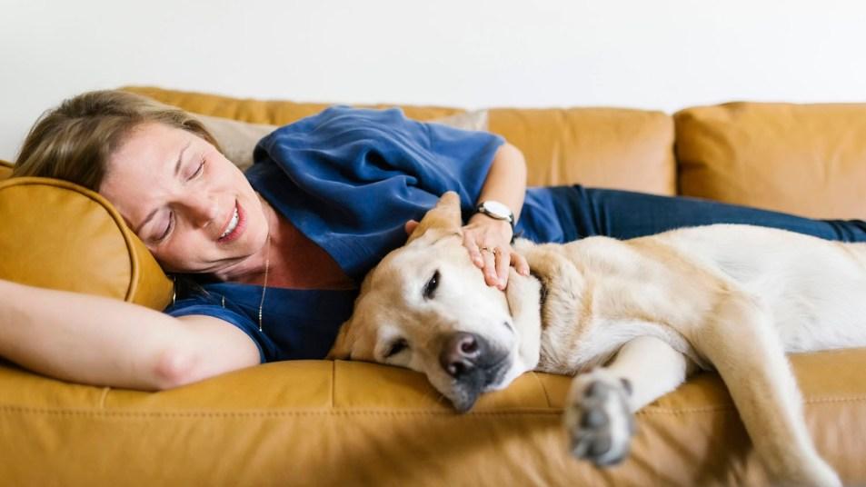 woman on sofa with dog