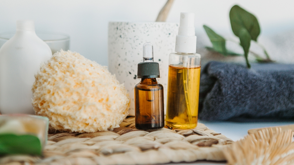essential oils and sponge in a bathroom