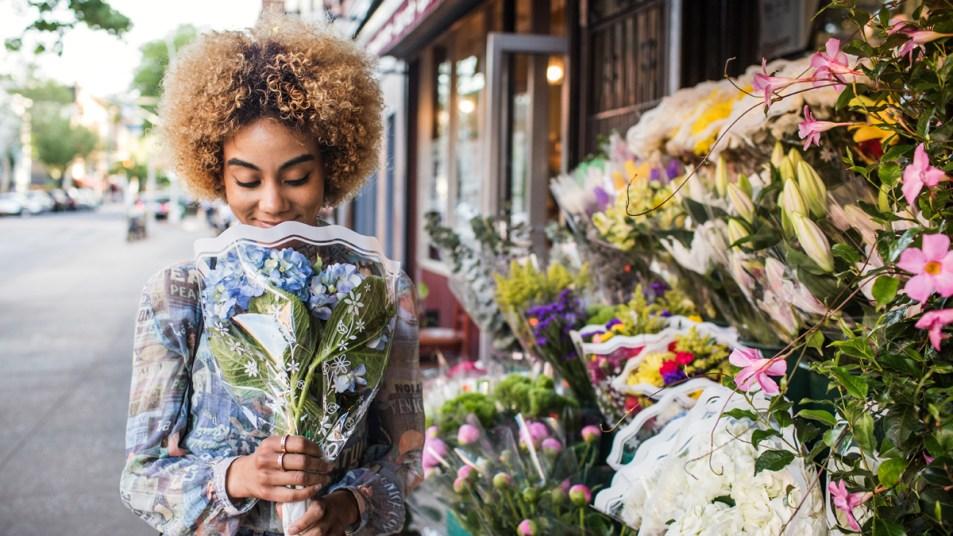 Woman smelling bouquet