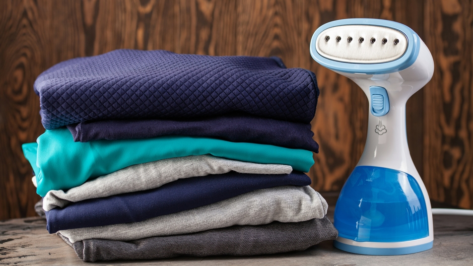 handheld steamer next to a stack of clothes