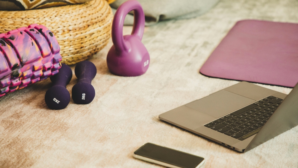 Weights around a laptop and phone