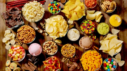 Table full of chips, candy, and other snacks
