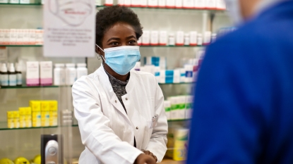 Pharmacist working with a mask on