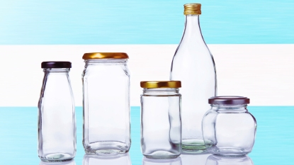 Clear jars of various sizes with blue stripe background