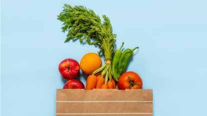 Bag of groceries with blue background