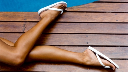 Woman's legs with flip flops on her feet