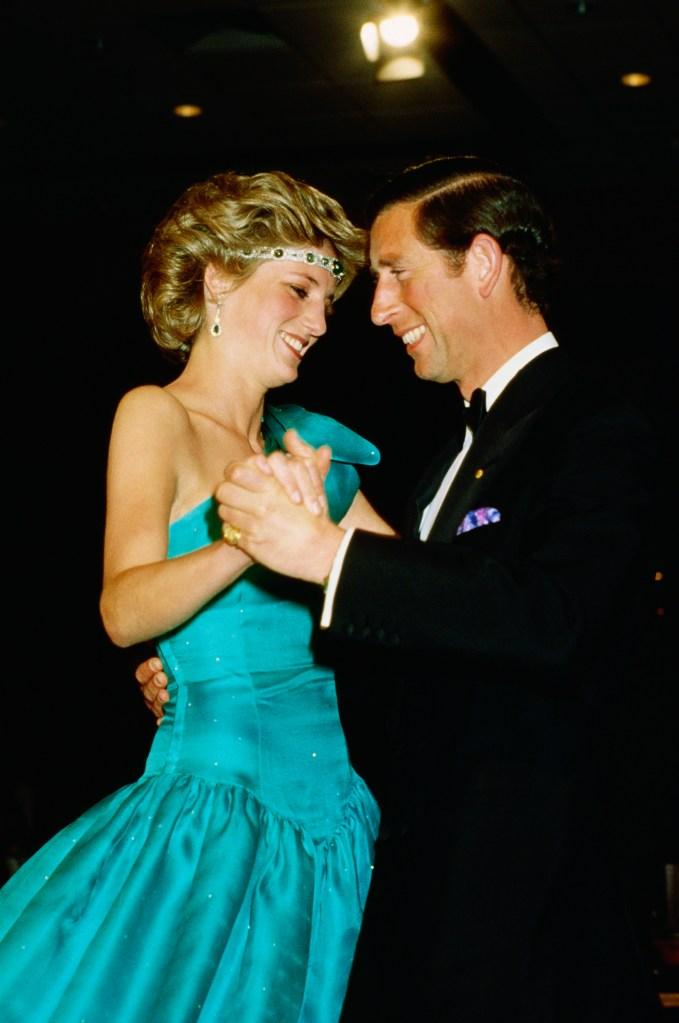 Princess Diana wearing an emerald chocker as a headband while dancing with Prince Charles
