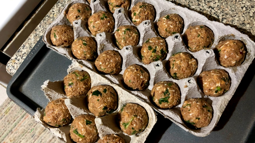 Unbaked meatballs in egg cartons