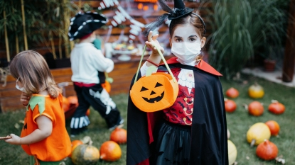 Kids in Halloween costumes with COVID-19 face masks