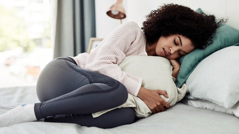 Woman curled up in bed