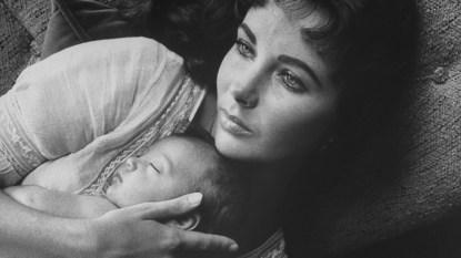 Elizabeth Taylor holding baby