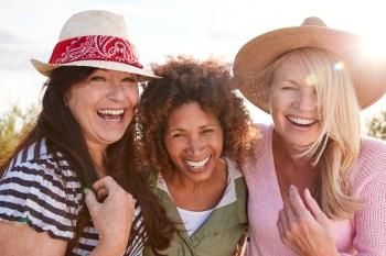 three mature female friends smiling
