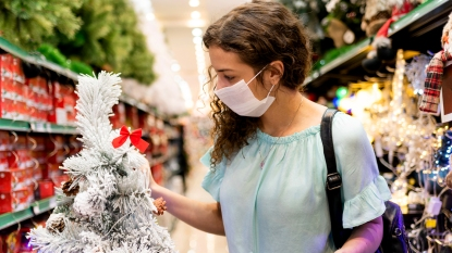 Woman holiday shopping with a mask on