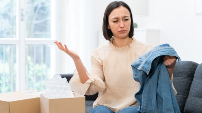 Woman Receiving Clothing Delivery