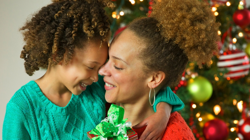 Mom and daughter hugging with Christmas presents