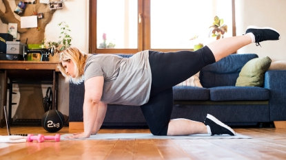 Woman exercising in living room