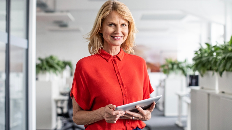 Older woman smiling in an office