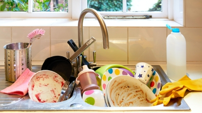 Sink full of dirty dishes