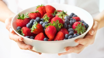 Woman holding a bowl of berries
