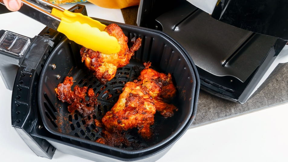 Air fryer with messy BBQ chicken