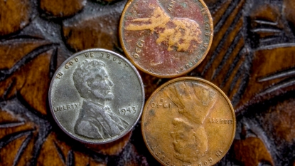 Silver penny with copper pennies